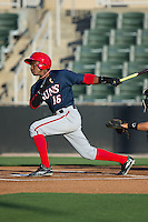 Victor Robles (16) of the Hagerstown Suns follows through on his swing against the Kannapolis Intimidators at Kannapolis Intimidators Stadium on May 4, 2016 in Kannapolis, North Carolina.  The Intimidators defeated the Suns 7-4.  (Brian Westerholt/Four Seam Images)