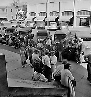 Streetside Congregation: Outside the Labor Temple where the conference called by the Steinbeck Committee during the cotton strike is being held. Bakersfield, California. November 1938.<br /> <br /> Photo by Dorothea Lange.