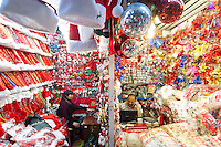 November 27, 2015, Yiwu China - Vendors sit at desks separated by thin partition between their stalls of Chrismtas decorations inside the Festival Arts section of the Yiwu International Trade Market. Yiwu International Trade Market is the world's largest whole sale market for small commodities. Christmas decorations are available for bulk purchase all the year round.Photo by Dave Tacon / Sinopix