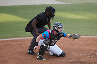 Pescados de Carolina catcher Wes Clarke (5) frames a pitch as home plate umpire Tre Jester looks on during the game against the Delmarva Shorebirds at Five County Stadium on September 4, 2021 in Zebulon, North Carolina. (Brian Westerholt/Four Seam Images)