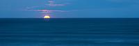 Full moon sets below horizon before sunrise in Punakaiki, Paparoa National Park, West Coast, Buller Region, New Zealand, NZ