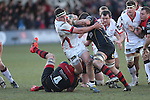 Dragons pair Andrew Coombs and James Benjamin tackle Ulster hooker Rob Herring.<br /> Guinness Pro12<br /> Gwent Dragons v Ulster<br /> 08.03.15<br /> ©Steve Pope - SPORTINGWALES