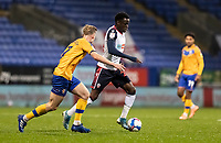 Bolton Wanderers' Arthur Gnahoua (centre)  competing with Mansfield Town's Harry Charsley<br /> <br /> Photographer Andrew Kearns/CameraSport<br /> <br /> The EFL Sky Bet League Two - Bolton Wanderers v Mansfield Town - Tuesday 3rd November 2020 - University of Bolton Stadium - Bolton<br /> <br /> World Copyright © 2020 CameraSport. All rights reserved. 43 Linden Ave. Countesthorpe. Leicester. England. LE8 5PG - Tel: +44 (0) 116 277 4147 - admin@camerasport.com - www.camerasport.com