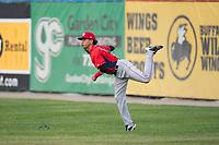 Orem Owlz right fielder Rayneldy Rosario (12) throws to second base during a Pioneer League game against the Missoula Osprey at Ogren Park Allegiance Field on August 19, 2018 in Missoula, Montana. The Missoula Osprey defeated the Orem Owlz by a score of 8-0. (Zachary Lucy/Four Seam Images)