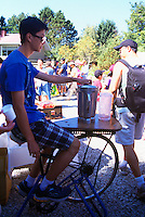 5th Annual Garlic Festival, August 2013 (hosted by The Sharing Farm) at Terra Nova Rural Park, Richmond, BC, British Columbia, Canada - Teenager cycles to make Smoothie Drinks