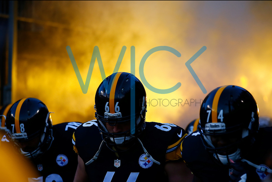 Members of the Pittsburgh Steelers enter the field against the Denver Broncos during the game at Heinz Field on December 20, 2015 in Pittsburgh, Pennsylvania. (Photo by Jared Wickerham/DKPittsburghSports)