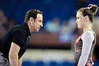 Oklahoma's Assistant Coach Tom Haley speaks to Chayse Capps before floor exercise semifinals of the NCAA women's gymnastics championships, Friday, April 17, 2015 in Fort Worth, Tex.(Mo Khursheed/TFV Media via AP Images)