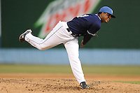Asheville Tourists pitcher Nelson Gonzalez #11 delivers a pitch during a game against the Lexington Legends at McCormick Field on May 5, 2012 in Asheville, North Carolina . The Legends defeated the Tourists 5-1. (Tony Farlow/Four Seam Images).