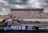 Sept. 1, 2013; Clermont, IN, USA: NHRA top fuel dragster driver Antron Brown (near lane races alongside Shawn Langdon during qualifying for the US Nationals at Lucas Oil Raceway. Mandatory Credit: Mark J. Rebilas-