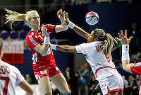 Norwayís Linn Jorum Sulland (L) vies with Spainís Marta Elisabet Mangue (R)during their Women's Handball World Championship 2013 match Norway vs Spain on December 7, 2013 in Zrenjanin.   AFP PHOTO / PEDJA MILOSAVLJEVIC