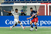 FOXBOROUGH, MA - NOVEMBER 20: Matt Polster #8 of New England Revolution passes the ball as Mustafa Kizza #12 of Montreal Impact defends during the Audi 2020 MLS Cup Playoffs, Eastern Conference Play-In Round game between Montreal Impact and New England Revolution at Gillette Stadium on November 20, 2020 in Foxborough, Massachusetts.