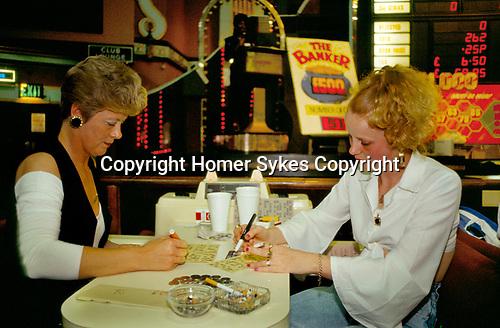 Bingo UK women smoking  playing Bingo Club  north London. 1990s 90s