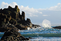 Waves crashing on craggy cliffs on the Oregon Coast