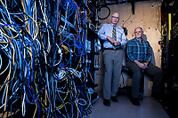 City of Sammamish Interim City Administrator Larry Patterson, left, and Interim IT Director Steve Schommer, in a server room at city offices. The City of Sammamish has been forced to confront a ransomware case afflicting the area's computer systems, along the way bringing on new IT staff and protocols. Photo by Daniel Berman