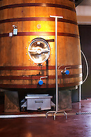 Wooden fermentation tank. In front of it a stick - pigeur - for pushing down the cap of grape skins to increase extraction, pigeage. Bodega Bouza Winery, Canelones, Montevideo, Uruguay, South America