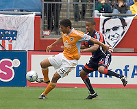 Houston Dynamo forward Brian Ching (25) works against New England Revolution defender Darrius Barnes (25). The Houston Dynamo defeated the New England Revolution, 2-0, at Gillette Stadium on May 3, 2009.