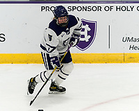 WORCESTER, MA - JANUARY 16: Bryn Saarela #5 of Holy Cross looks to pass during a game between Boston College and Holy Cross at Hart Center Rink on January 16, 2021 in Worcester, Massachusetts.