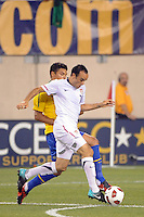 Landon Donovan (10) of the United States is marked by Thiago Silva (3) of Brazil. The men's national team of Brazil (BRA) defeated the United States (USA) 2-0 during an international friendly at the New Meadowlands Stadium in East Rutherford, NJ, on August 10, 2010.