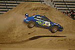 Driver Travis Pastrana and co-driver Christian Edstrom get some air while competing in the Rally Car Race finals during X-Games 12 in Los Angeles, California on August 5, 2006.