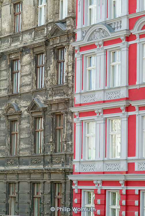 Restored and decaying buildings side-by-side in the Kreuzberg district of Berlin.