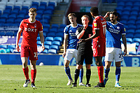 Referee James Garner (C) speaks to Ryan Yates of Nottingham Forest (L) Will Vaulks, Marlon Pack of Cardiff City and Sammy Ameobi of Nottingham Forest (R) before a free kick during the Sky Bet Championship match between Cardiff City and Nottingham Forest at the Cardiff City Stadium, Cardiff, Wales, UK. Friday 02 April 2021