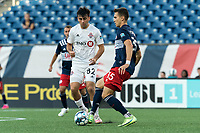 FOXBOROUGH, MA - JULY 9: Colin Verfurth #35 of New England Revolution II passes the ball as Julian Altobelli #82 of Toronto FC II closes during a game between Toronto FC II and New England Revolution II at Gillette Stadium on July 9, 2021 in Foxborough, Massachusetts.