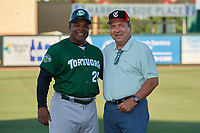 Hall of Fame Catcher Johnny Bench (right) poses for a photo with coach Lenny Harris before a Florida State League game between the Daytona Tortugas and Palm Beach Cardinals on April 11, 2019 at Roger Dean Stadium in Jupiter, Florida.  Palm Beach defeated Daytona 6-0.  (Mike Janes/Four Seam Images)