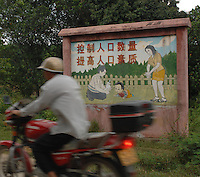 "Propoganda posters adorn the countryside that advise parents that tell them that having too many children will ruin socity. this one reads: ""Improve the quality of the population and control the numbers""<br /> ©sinopix"