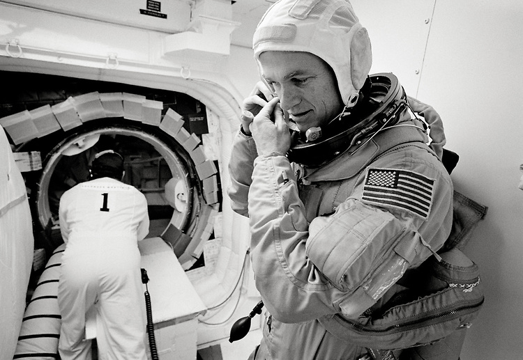 Image copyright John Angerson. <br /> STS-72 mission training.<br /> Space Shuttle pilot Brent W. Jett Jr. in the 'White Room' of the Endeavour (OV-105) orbiter. This area could only accommodate one or two astronauts at a time during boarding. With assistance, each member of the flight crew donned a parachute pack and crawled through the open hatch and into the shuttle. <br /> Kennedy Space Centre, Florida, USA.