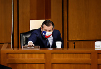 United States Senator Ted Cruz (Republican of Texas) is seated prior to a Senate Judiciary Committee hearing on the nomination of Judge Merrick Garland to be U.S. Attorney General on Capitol Hill in Washington, U.S., February 22, 2021.  <br /> Credit: Carlos Barria / Pool via CNP /MediaPunch
