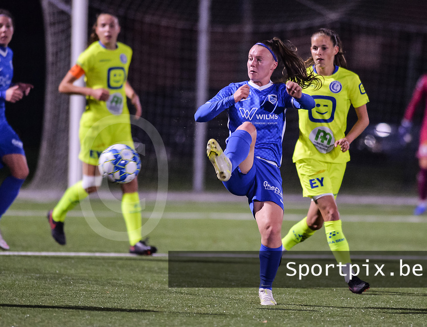 Fleur Pauwels (66) of KRC Genk and Shari Van Belle (8) of AA Gent pictured during a female soccer game between  Racing Genk Ladies and AA Gent Ladies ,  on the 6 th  matchday of the 2021-2022 season of the Belgian Scooore Womens Super League , friday 8 october 2021  in Genk , Belgium . PHOTO SPORTPIX   JILL DELSAUX