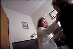 doctor comforting worried patient in office
