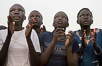 Young women watch a football match at the Twic Olympics in Wunrok, Southern Sudan.