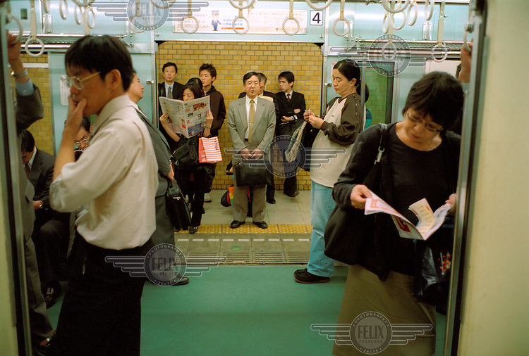 Commuters waiting for a train.