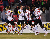 Michael Sauers (3) of Maryland celebrates his goal with teammate Mikey Ambrose (5) during the second round of the NCAA tournament at Ludwig Field in College Park, MD.  Maryland defeated Providence, 3-1.