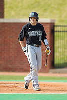 Connor Owings (6) of the Coastal Carolina Chanticleers walks back to the dugout after having been called out on strikes against the High Point Panthers at Willard Stadium on March 15, 2014 in High Point, North Carolina.  The Chanticleers defeated the Panthers 1-0 in the first game of a double-header.  (Brian Westerholt/Four Seam Images)