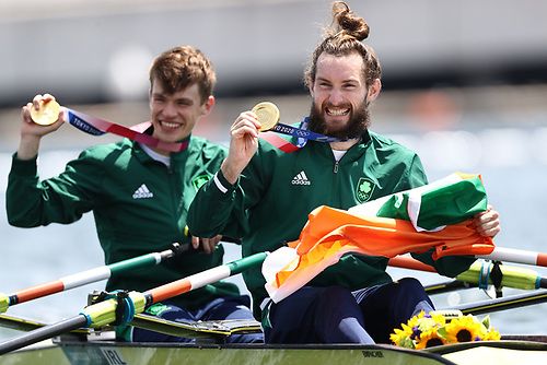 Fintan McCarthy and Paul O'Donovan celebrate after winning gold.