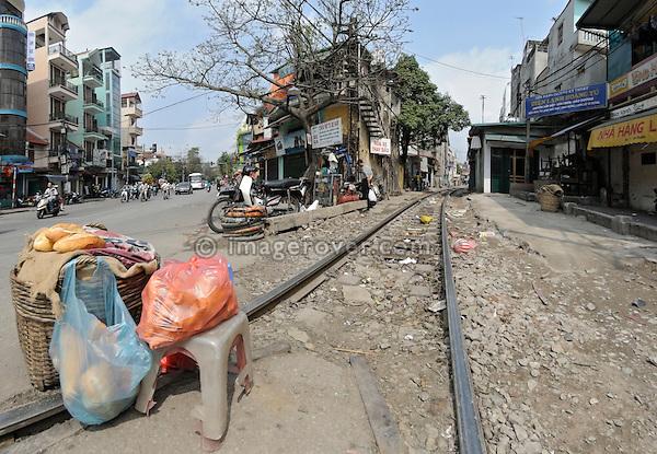Asia, Vietnam, Hanoi. Railway track leading through Hanoi's centre.