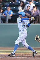 Luke Persico #21 of the UCLA Bruins bats against the Cal Poly Mustangs at Jackie Robinson Stadium on February 22, 2014 in Los Angeles, California. Cal Poly defeated UCLA, 8-0. (Larry Goren/Four Seam Images)
