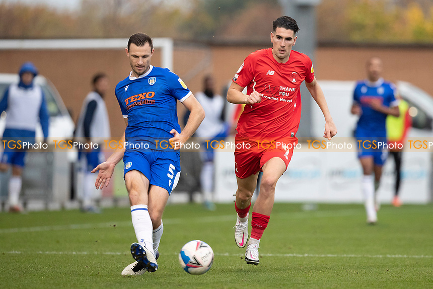 Tommy Smith, Colchester United plays back under pressure from Connor Wilkinson, Leyton Orient during Colchester United vs Leyton Orient, Sky Bet EFL League 2 Football at the JobServe Community Stadium on 14th November 2020