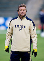 Notre Dame head coach Randy Waldrum watches his team warm up before the first game of the NCAA Women's College Cup at WakeMed Soccer Park in Cary, NC.  Notre Dame defeated Ohio State, 1-0.