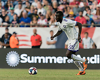 FOXBOROUGH, MA - JULY 27: Lamine Sane #22 dribbles during a game between Orlando City SC and New England Revolution at Gillette Stadium on July 27, 2019 in Foxborough, Massachusetts.
