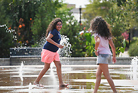 Selma Singleterry, 10, (from left) and Melina Singleterry, 8, of Rogers play, Sunday, September 12, 2021 at the Lawrence Plaza splash pad in Bentonville.  Sunday was the last day to enjoy the Fountains at Lawrence Plaza. Look for details soon about the Rink at Lawrence Plaza, which is scheduled to open on Saturday, Nov. 20, according to the city's Facebook page. Check out nwaonline.com/210913Daily/ for today's photo gallery. <br /> (NWA Democrat-Gazette/Charlie Kaijo)