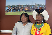 10 June 2014. Kayapo Chiefs Raoni Metuktire and Megaron Txucarramae during their visit to London. The chiefs stand proudly for a portrait in front of a photograph of Kayapo warriors, women and children standing by the Xingu River to send a message about the dams.