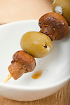 26 January 2012 -- Tapas meal. The Tapas meal includes: pears in a nest of potatoes, mushroom skewered with blue cheese green olives, gold sprayed chocolate covered pretzels and nuggets. Picture by Daniel Johnson (Copyright 2012 Daniel Johnson)