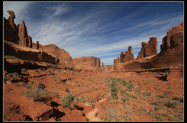 Hiking trail through the Park Avenue rock formations, Arches National Park, Utah.<br />