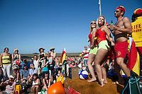 Wells Next The Sea, Norfolk, England, 08/08/2009..Lifeguards at Wells summer carnival parade.