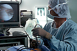 Surgeon repairs knee with arthroscopy