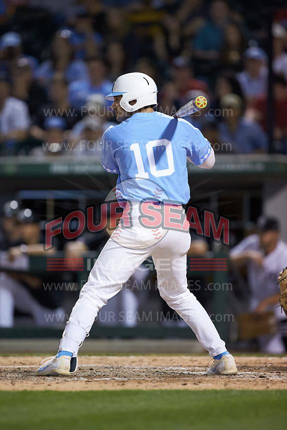 Zack Gahagan (10) of the North Carolina Tar Heels at bat against the South Carolina Gamecocks at BB&T BallPark on April 3, 2018 in Charlotte, North Carolina. The Tar Heels defeated the Gamecocks 11-3. (Brian Westerholt/Four Seam Images)