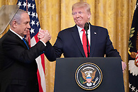 President Trump Unveils a Plan for a Comprehensive Peace Agreement Between Israel and the Palestinians<br /> <br /> President Donald J. Trump delivers remarks with Israeli Prime Minister Benjamin Netanyahu Tuesday, Jan. 28, 2020, in the East Room of the White House to unveil details of the Trump administration's Middle East Peace Plan. (Official White House Photo by Shealah Craighead)